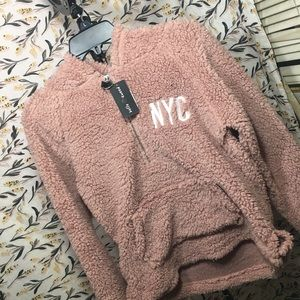 Cal & Nyc plush pullovers.